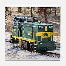 Yellow and green miniature train engi Tile Coaster