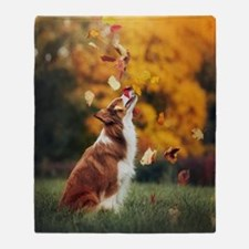 Dog Catching Leaves Throw Blanket