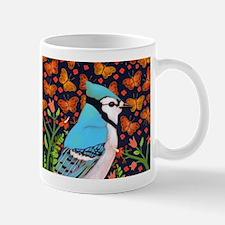 BLUE BIRD WITH ORANGE FLOWERS AND BUTTERFLIES Mugs