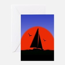 Sailboat at Sunset Greeting Cards