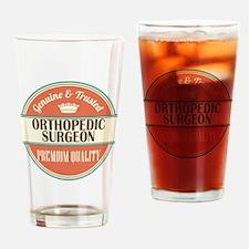 orthopedic surgeon vintage logo Drinking Glass