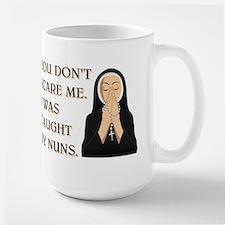 TAUGHT BY NUNS Large Mug