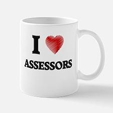 I love Assessors (Heart made from words) Mugs