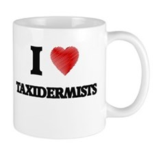I love Taxidermists (Heart made from words) Mugs