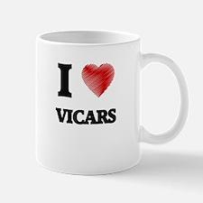 I love Vicars (Heart made from words) Mugs