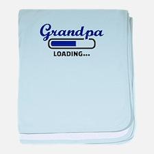 Grandpa loading baby blanket