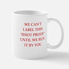 idiot proof Mugs