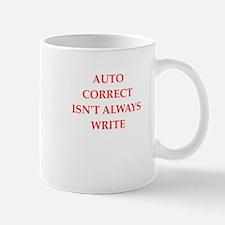 auto correct Mugs