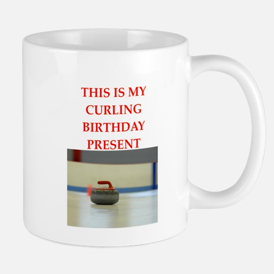 a birthday present Mugs