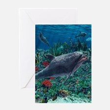 Dolphins play in the reef Greeting Cards