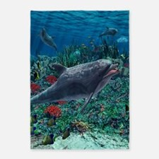 Dolphins play in the reef 5'x7'Area Rug