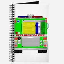 Traditional green fire engine rear view Journal