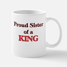 Proud Sister of a King Mugs
