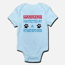 Warning Protected by a Petit Basse Infant Bodysuit