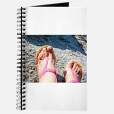 Golden sand on the feet at the ocean beach Journal