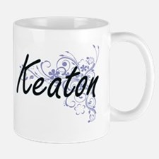 Keaton surname artistic design with Flowers Mugs