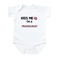 Kiss Me I'm a PRAXEOLOGIST Infant Bodysuit