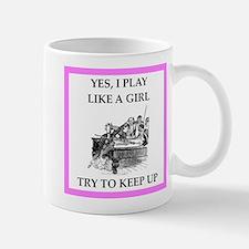 play ike a girl Mugs