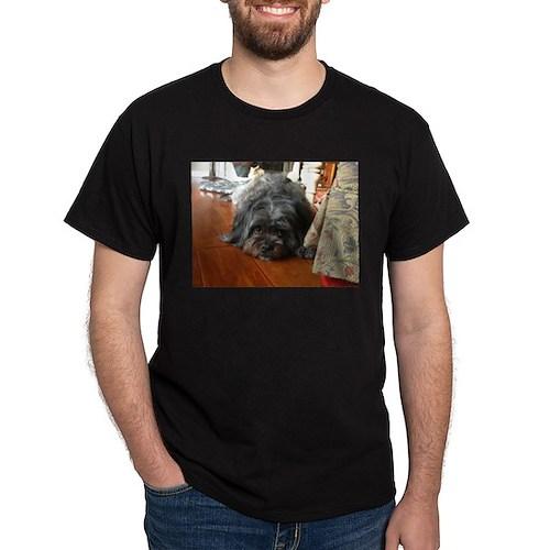 Kona wide eyed dog on wooden floor T-Shirt