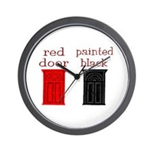 red door painted black Wall Clock