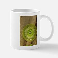 green Depression glass plate in garden Mugs