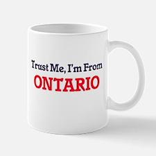 Trust Me, I'm from Ontario California Mugs