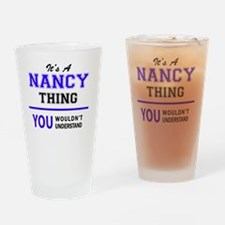 It's NANCY thing, you wouldn't unde Drinking Glass