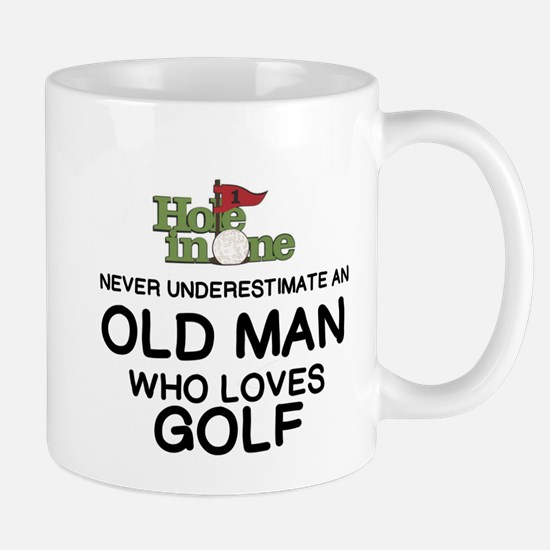 NEVER UNDERESTIMATE AN OLD MAN WHO LOVES GOLF Mugs