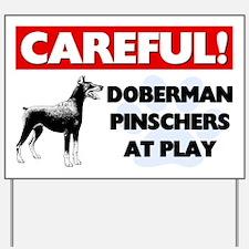 Careful Doberman Pinschers At Play Yard Sign