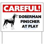 Careful Doberman Pinscher At Play Yard Sign