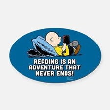 Charlie Brown - Reading is an Adve Oval Car Magnet