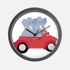 Funny elephants in red beetle car Wall Clock