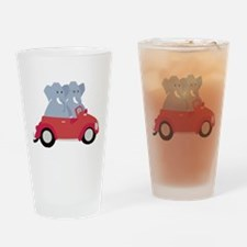 Funny elephants in red beetle car Drinking Glass