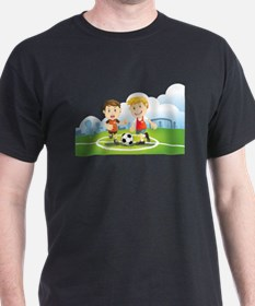 Two boys play soccer on a field T-Shirt