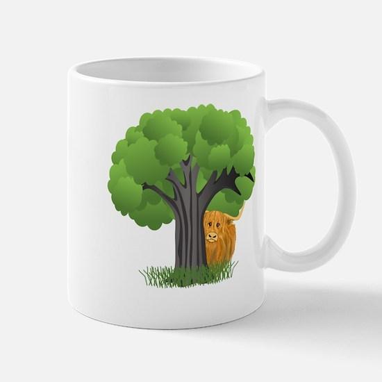 Woolly Moo behind tree Mugs