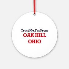 Trust Me, I'm from Oak Hill Ohio Round Ornament