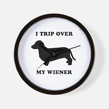 I trip over my wiener Wall Clock