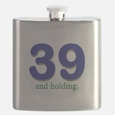 39 and holding Flask