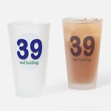 39 and holding Drinking Glass