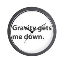 Gravity Gets Me Down Wall Clock