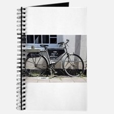 Vintage Bicycle with advertising sign Journal