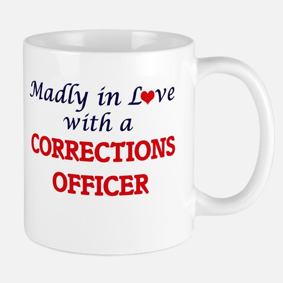 Madly in love with a Corrections Officer Mugs