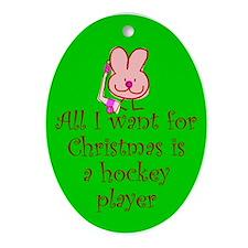 Christmas Oval Ornament. Puck Bunny.