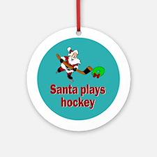 Ornament (Round). Santa plays hockey