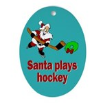 Oval Ornament. Santa plays hockey.