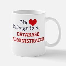 My heart belongs to a Database Administrator Mugs