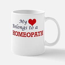 My heart belongs to a Homeopath Mugs