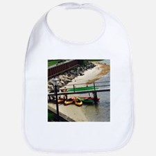 Colorful Kayaks under Dock Bib