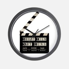 Shoot film, not guns Wall Clock