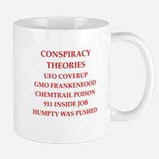 conspiracy theories Mugs